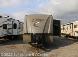 Used 2013  Keystone Cougar High Country 319RLS by Keystone from Lakeshore RV Center in Muskegon, MI