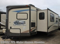 Used 2013  Coachmen Freedom Express 302FKV by Coachmen from PPL Motor Homes in Houston, TX