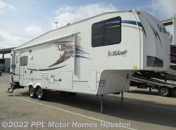Used 2012  Forest River Wildcat 302RL by Forest River from PPL Motor Homes in Houston, TX