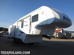 Used 2012  Heartland RV Prowler 29P Ti by Heartland RV from Ted's RV Land in Paynesville, MN