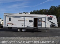 Used 2010  Forest River Wildwood SRV 32SRV by Forest River from Delmarva RV Center in Seaford in Seaford, DE