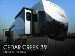 Used 2012  Forest River Cedar Creek 39 by Forest River from POP RVs in Sarasota, FL
