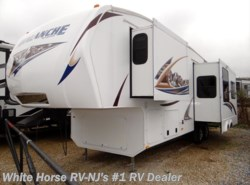 Used 2011 Keystone Avalanche 290RL Rear Living Triple Slide available in Williamstown, New Jersey