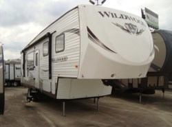 Used 2015  Forest River Wildwood 29RKSS by Forest River from Camperland Trailer Sales in Conroe, TX