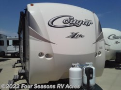 New 2018  Keystone Cougar XLite 28RLS by Keystone from Four Seasons RV Acres in Abilene, KS