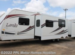 Used 2012  Keystone Laredo 303TG by Keystone from PPL Motor Homes in Houston, TX