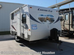 Used 2013  Palomino Canyon Cat 15UDC by Palomino from PPL Motor Homes in Houston, TX