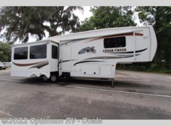 Used 2011  Forest River Cedar Creek 34RLSA by Forest River from Optimum RV in Ocala, FL