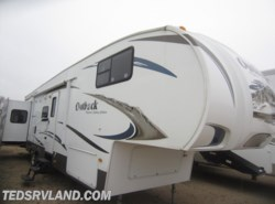 Used 2010  Keystone Outback 329FBD by Keystone from Ted's RV Land in Paynesville, MN