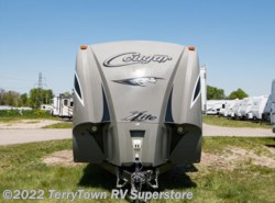 Used 2014  Keystone Cougar XLite 32RET by Keystone from TerryTown RV Superstore in Grand Rapids, MI
