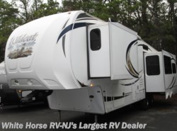 Used 2012  Forest River Wildcat 313RE Rear Entertainment Triple Slide