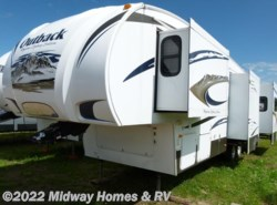 Used 2010  Keystone Outback Sydney Edition 325FRE by Keystone from Midway Homes & RV in Grand Rapids, MN