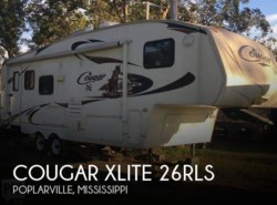 Used 2010 Keystone Cougar XLite 26RLS available in Sarasota, Florida