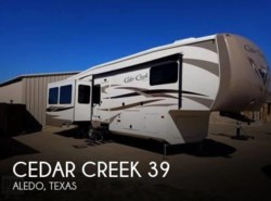 Used 2015  Forest River Cedar Creek 39 by Forest River from POP RVs in Sarasota, FL