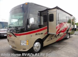 Used 2014  Thor Motor Coach Outlaw 37LS Toy Hauler with Sofa/Dinette Slide-out by Thor Motor Coach from White Horse RV Center in Williamstown, NJ