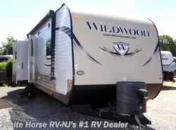 Used 2014  Forest River Wildwood 31BKIS 2-BdRM Triple Slide with Outside Kitchen