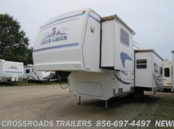 Used 2003  Forest River Cedar Creek 30RLBS by Forest River from Crossroads Trailer Sales, Inc. in Newfield, NJ